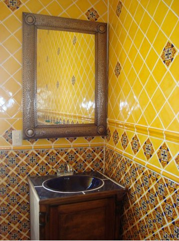 mexican tile in bathroom with tin mirror mexican home