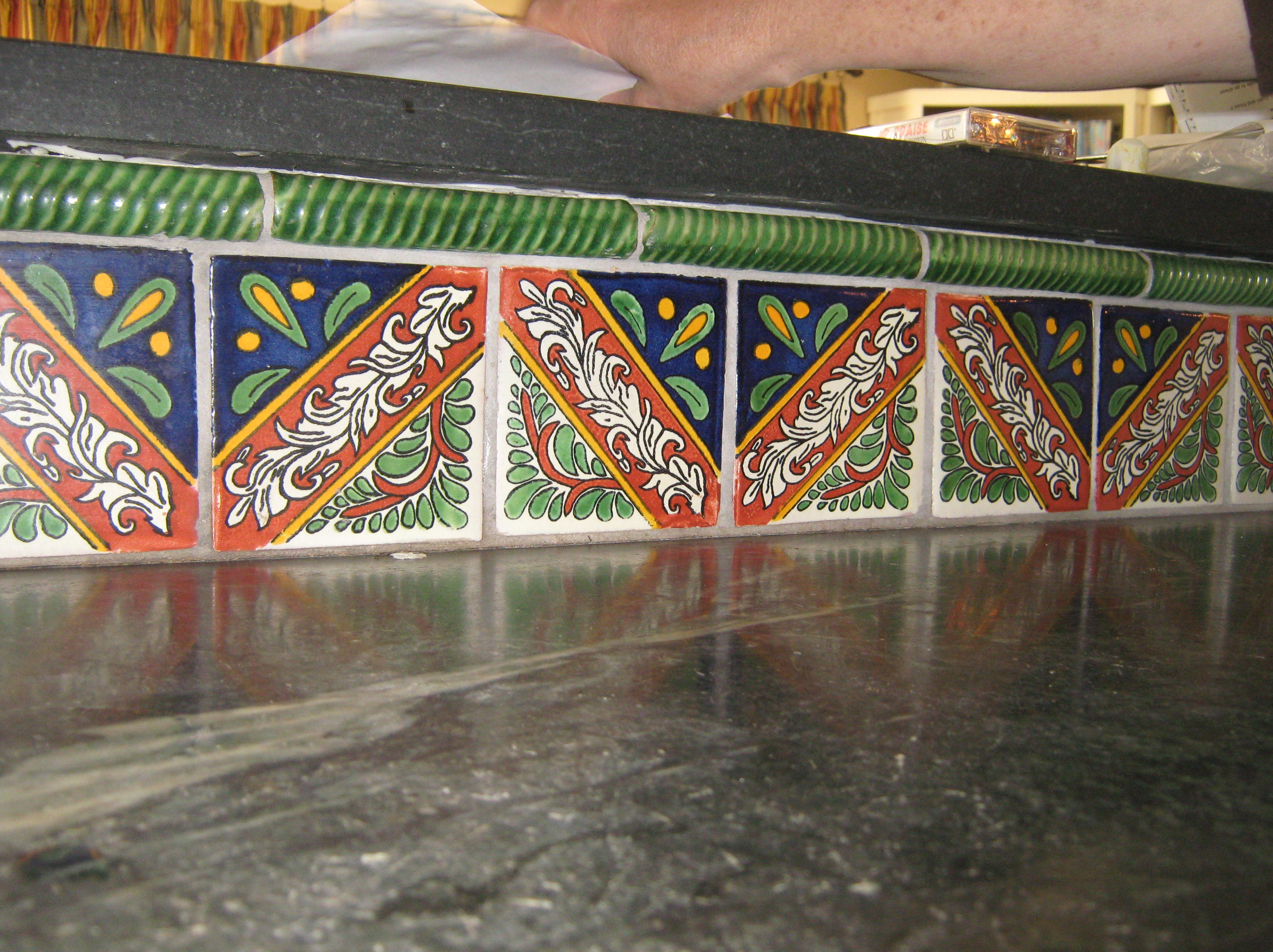 Backsplash of mexican tile in a countertop mexican home decor this back splash uses morelia talavera mexican tile and green talavera clay rope as a border on top of the tile dailygadgetfo Image collections
