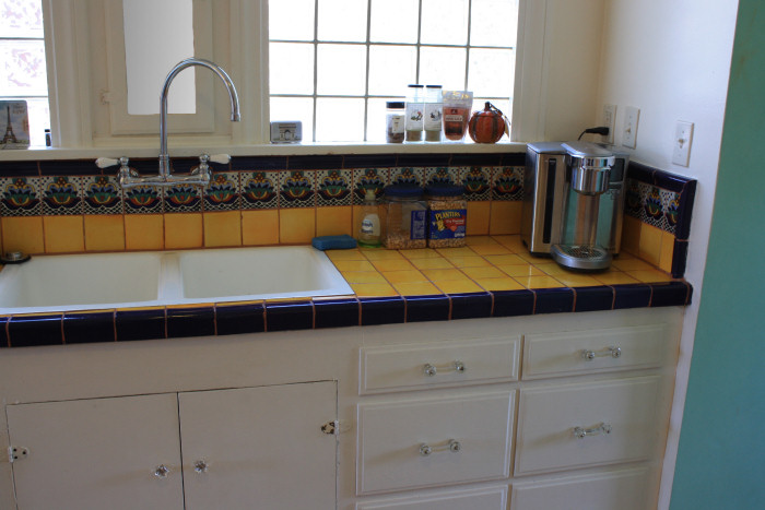 Mexican Tile In A Kitchen Counterop And Backsplash
