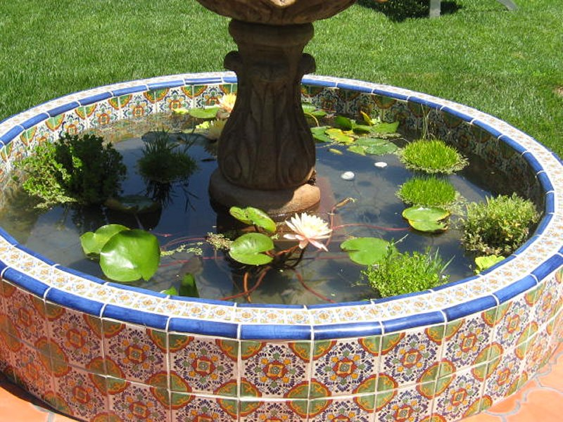 Mexican Tile Around A Pond And Stone Fountain Closeup