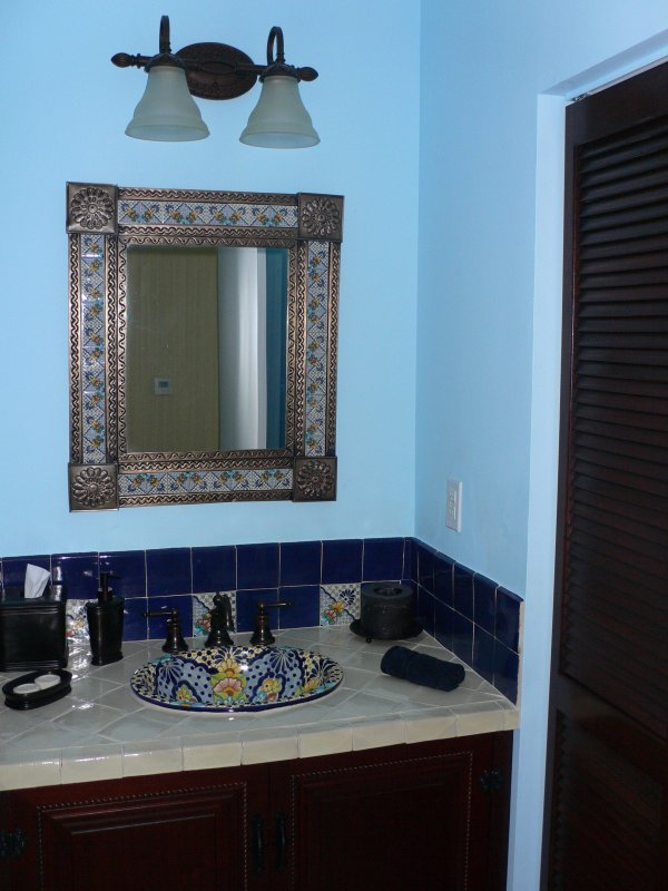 Powder Room Tin Mirror Along A Ceramic Talavera Sink