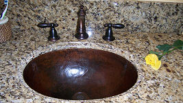 hammered copper bathroom sink after 2 years of use